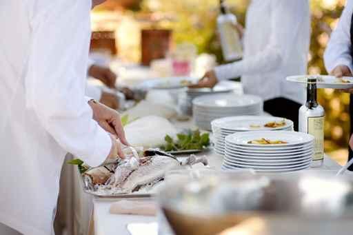 Waiter serving a tasty fish